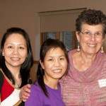 Maggie Cullman with her two students, Rose and Lan
